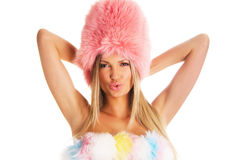 Seductive woman in a fur hat. Portrait of a young woman in a fashionable fur clothing Stock Images