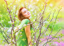 Seductive woman in the garden Stock Images