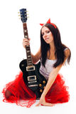 Seductive woman with guitar Royalty Free Stock Images