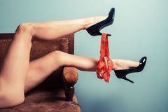 Seductive woman in heels on sofa Royalty Free Stock Images