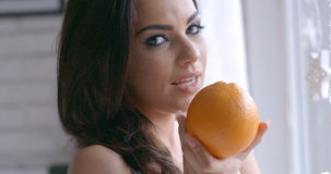 Seductive Woman Holding Fresh Orange Fruit Stock Photo