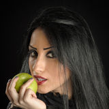 Seductive Woman Holding Green Apple Stock Photos