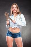 Seductive woman holding monkey wrench. Feminism. Royalty Free Stock Photography