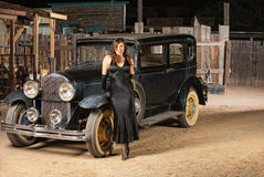 Seductive Woman Leaning on Car Stock Images