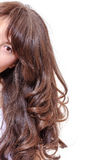 Seductive woman with long brunette hair Royalty Free Stock Image