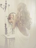 Seductive woman in the mirror Royalty Free Stock Images
