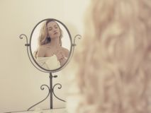 Seductive woman in the mirror. Nude elegant blonde woman in front of the mirror Stock Photography
