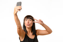 Seductive woman pouting while taking a selfie Royalty Free Stock Images