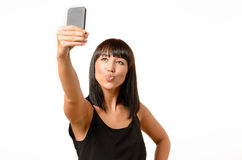 Seductive woman pouting while taking a selfie Stock Photography