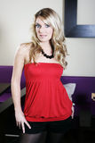 Seductive Woman in Red Tube Top and Black Shorts Stock Photo