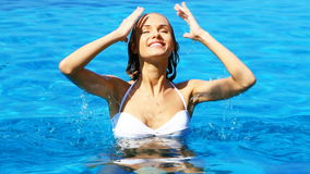 Seductive woman relaxing in swimming pool Royalty Free Stock Photo