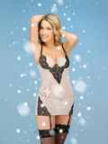 Seductive woman in sexy lingerie with snow Stock Photography
