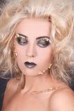 Seductive woman with shaggy hair and creative makeup Royalty Free Stock Photos