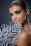 Seductive woman with silver fan Royalty Free Stock Photo