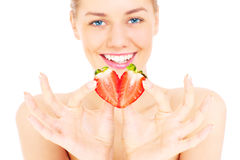 Seductive woman with strawberry Royalty Free Stock Photos