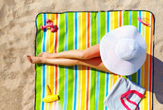 Seductive woman taking sunbathe on beach Stock Image