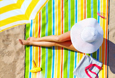 Seductive woman taking sunbathe on beach Royalty Free Stock Photo