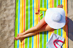 Seductive woman taking sunbathe on beach Stock Photography
