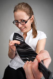 Seductive woman taking you by the tie Stock Photo