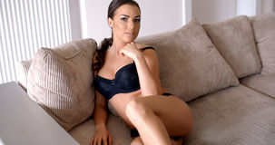 Seductive Woman in Underwear Sitting at the Sofa Stock Image