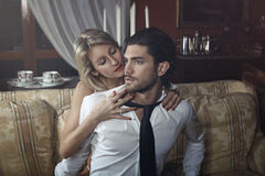 Seductive woman undressing handsome man Royalty Free Stock Photography