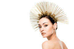Seductive woman wearing golden headpiece and looking at camera Stock Images