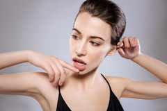 Seductive woman working on a new set of poses Stock Images