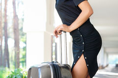 Seductive women with luggage Stock Photography
