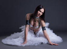 Seductive young belly dancer posing at camera Royalty Free Stock Images