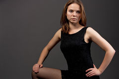 Seductive young blonde in black evening dress stock photos