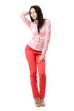 Seductive young brunette in red jeans.  Royalty Free Stock Photo
