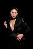 Seductive brunette wearing a black suit Stock Photo