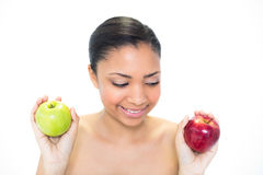 Seductive young dark haired model holding apples Stock Image