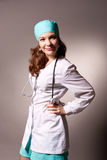 Seductive young doctor with endoscope Stock Images