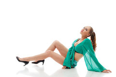 Seductive young girl posing in green erotic outfit Royalty Free Stock Photos