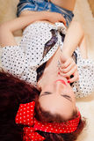 Seductive  young redhead woman relaxing on her Stock Images