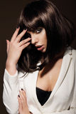 Seductive Young Woman with Dark Hair Stock Photo