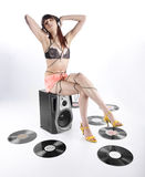 Seductive Young Woman Enjoying Music on Headphone Royalty Free Stock Images