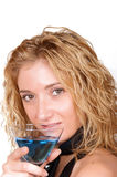 Seductive, young woman holding a Martini glass. Seductive, young blond woman holding a Martini glass and looking at the camera Royalty Free Stock Photo