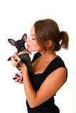 Seductive young woman kissing Chihuahua isolated on white Royalty Free Stock Image