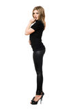 Seductive young woman in leggings. Isolated Royalty Free Stock Image