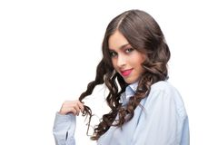 Seductive young woman in a man shirt Stock Photo