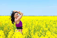 Seductive young woman in rape flower field Royalty Free Stock Image
