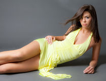 Seductive Young Woman in Slinky Dress Royalty Free Stock Images