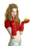 Seductress. Young woman in costume of succubus holding green apple Stock Image