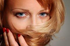 Seductress. Beautiful blond woman close up Stock Photos