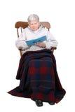 Seduta anziana della signora Immagine Stock