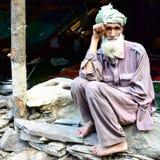 Seduta bakarwal nomade fotografia stock