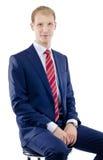 Seduta caucasica dell'uomo di affari Fotografia Stock Libera da Diritti