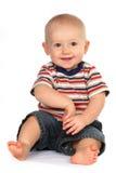 Seduta del bambino del neonato e mano sveglie della holding Fotografie Stock Libere da Diritti
